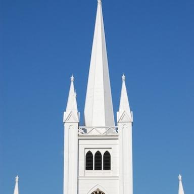 white church steeple against blue sky