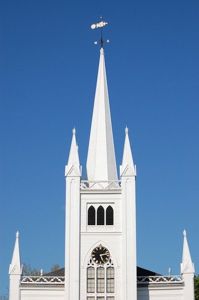 white church steeple against blue sky